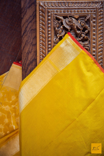 This is a beautiful banarasi katan silk handwoven sari with a yellow body and a rich zari jangla all over with just a hint of red in the form of the selvedge to complete it. New trend of Banarasi Saree designs, Banarasi Saree for artists, art lovers, architects, saree lovers, Saree connoisseurs, musicians, dancers, doctors, Banarasi Katan silk saree, indian saree images, latest sarees with price, only saree images, new Banarasi saree design.