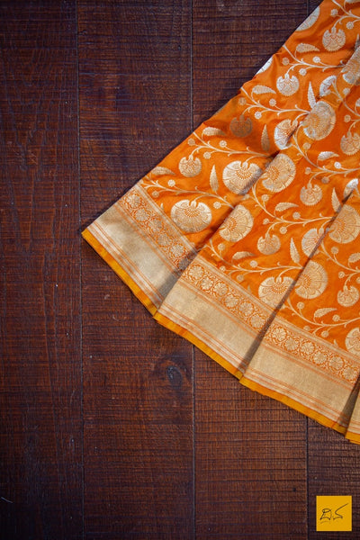 A beautiful pure katan silk banarasi handwoven sari with the jangla weave. The jaal is intricate and the blouse is a rich brocade woven in zari. New trend of Banarasi Saree designs, Banarasi Saree for artists, art lovers, architects, saree lovers, Saree connoisseurs, musicians, dancers, doctors, Banarasi Katan silk saree, indian saree images, latest sarees with price, only saree images, new Banarasi saree design.