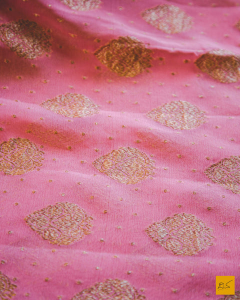 This is a wonderful georgette banarasi handwoven saree with a pink body and antique zari buttas. New trend of Banarasi saree designs, Banarasi saree for artists, art lovers, architects, saree lovers, saree connoisseurs, musicians, dancers, doctors, Banarasi Katan silk saree, indian saree images, latest sarees with price, only saree images, new Banarasi saree design.