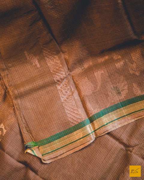 Brown yaali real zari silk kota handwoven saree which is great for both formal and informal gatherings, pair it with minimalistic jewellery