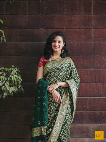 This is a gorgeous banarasi bandej saree with green colour body. The saree is plain and is accompanied with a lovely brocade blouse. New trend of bandej saree designs, bandej saree for artists, art lovers, architects, saree lovers, saree connoisseurs, musicians, dancers, doctors, bandej saree, indian saree images, latest sarees with price, only saree images, new bandej saree design.