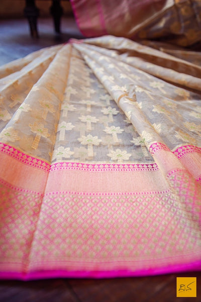 A lovely banarasi kora silk handwoven saree with its zari motifs along the length of the saree. The delicate pink border with golden zari work and meenakari adds to enrich the experience. New trend of Banarasi Saree designs, Banarasi Saree for artists, art lovers, architects, saree lovers, Saree connoisseurs, musicians, dancers, doctors, Banarasi silk saree, indian saree images, latest sarees with price, only saree images, new Banarasi saree design.