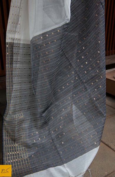 A lovely white and grey silk cotton handwoven saree with sequins woven in it. New trend of Saree designs, Saree for artists, art lovers, architects, saree lovers, Saree connoisseurs, musicians, dancers, doctors, silk saree, indian saree images, latest sarees with price, only saree images, new saree design.