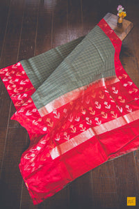 This is a gorgeous Banarasi Linen Silk handwoven Saree with zari checks woven on the body. The body is woven in linen and the border, pallu and blouse are woven in silk. The blouse is in red colour with woven border. New trend of Banarasi Saree designs, Banarasi Saree for artists, art lovers, architects, saree lovers, Saree connoisseurs, musicians, dancers, doctors, Banarasi silk saree, indian saree images, latest sarees with price, only saree images, new Banarasi saree design.