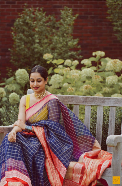 A wonderful banarasi kora silk handwoven sari. The body of the saree and the red blouse is woven in kora silk and the borders are in pink and red. A classic example of a kadhiyal saree. Tt is authentic Kadhiyal. New trend of Banarasi Saree designs, Banarasi Saree for artists, art lovers, architects, saree lovers, Saree connoisseurs, musicians, dancers, doctors, Banarasi silk saree, indian saree images, latest sarees with price, only saree images, new Banarasi saree design.