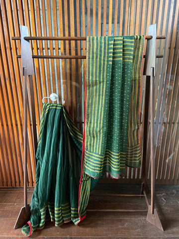 A lovely natural dye Emerald cotton Kota saree with subtle hints of red Kantha work. New trend of Saree designs, Saree for artists, art lovers, architects, saree lovers, Saree connoisseurs, musicians, dancers, doctors, silk saree, indian saree images, latest sarees with price, only saree images, new saree design.