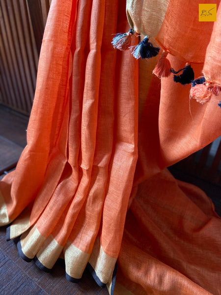 This is a gorgeous Linen handwoven Saree with a orange body. New trend of Saree designs, Saree for artists, art lovers, architects, saree lovers, Saree connoisseurs, musicians, dancers, doctors, linen saree, indian saree images, latest sarees with price, only saree images, new saree design.