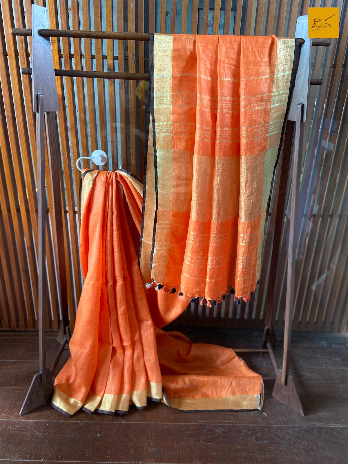 An orange linen saree which brings delight to the owner when draped. A perfect saree for work wear. Look gorgeous in this saree by pairing it with a printed or brocade blouse. This is a gorgeous Linen handwoven Saree with a orange body. New trend of Saree designs, Saree for artists, art lovers, architects, saree lovers, Saree connoisseurs, musicians, dancers, doctors, linen saree, indian saree images, latest sarees with price, only saree images, new saree design.