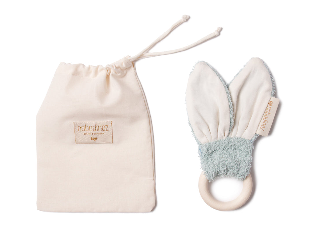 Natural Toy Store sells organic cotton baby teether ring like this cute bunny online. An eco-friendly gift to welcome a newborn ethically.
