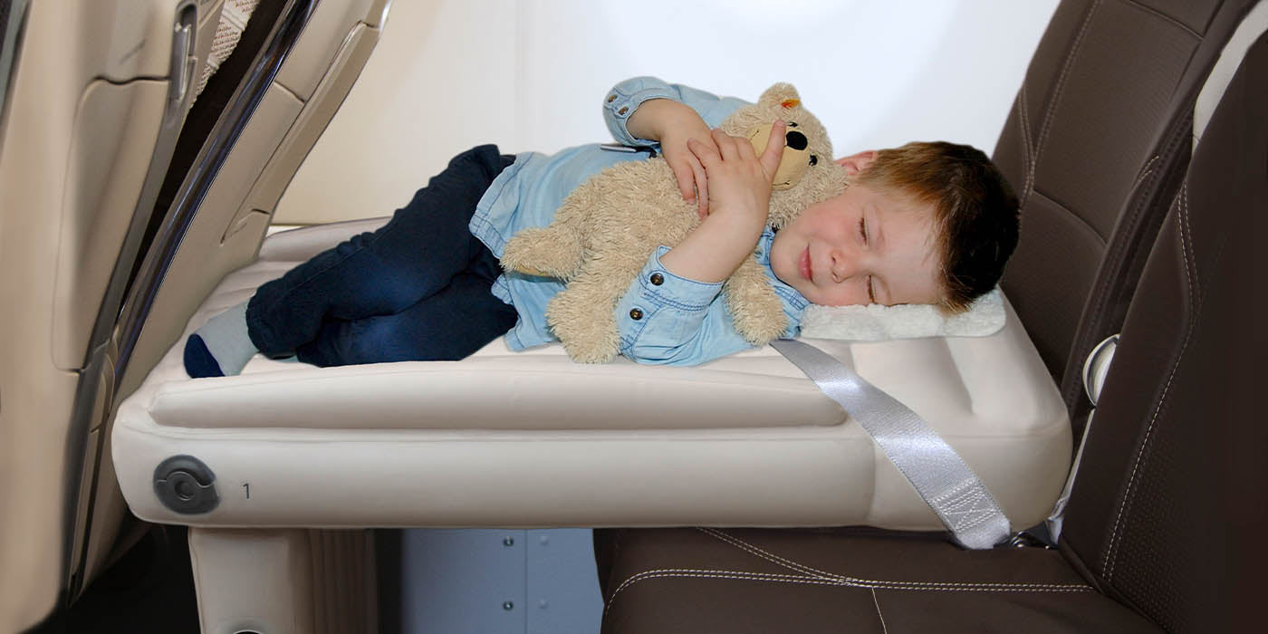 Flyaway Kids Bed sleeping child in plane