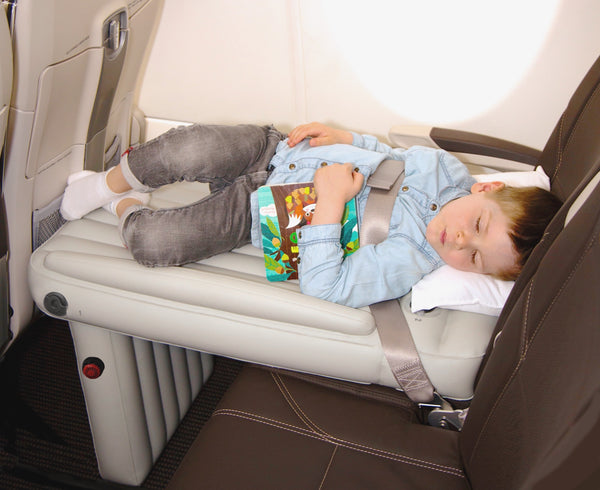Child sleeping with book on Flyaway Kids Bed