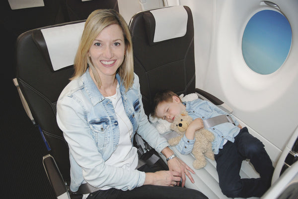 child sleeping on the plane with Flyaway Kids Bed