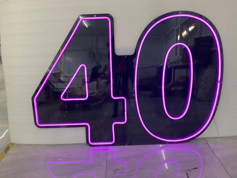 40th neon sign HIRE - Live Shopping Tours