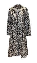Load image into Gallery viewer, A vintage 1960s black and white graphic print duster coat