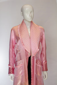 A Vintage 1950s Pink Robe with Quilted Collar and Pockets