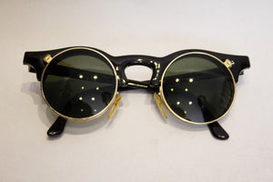 A pair of 1980s black linda farrow sunglasses