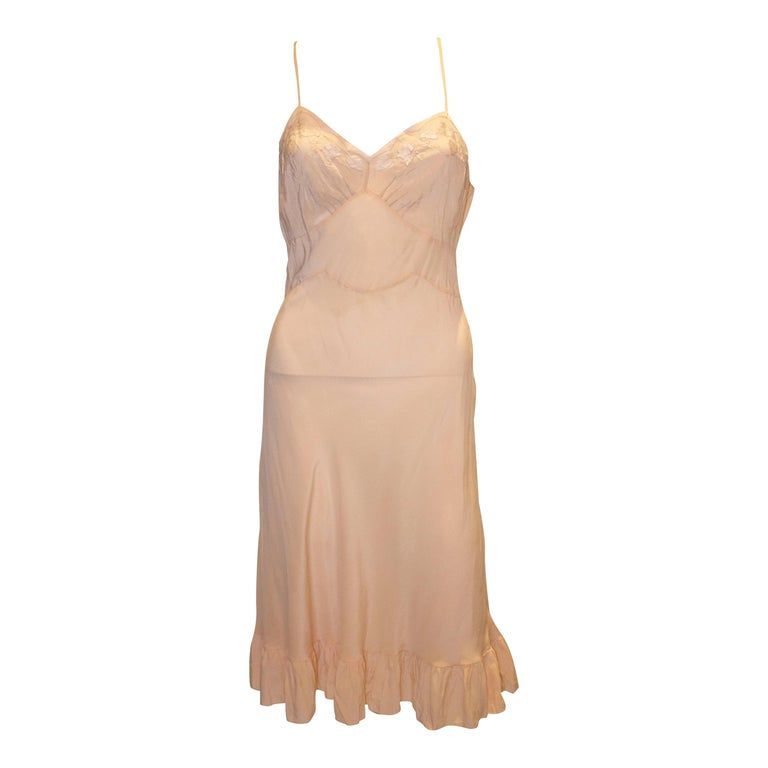 A Vintage 1940s Silk peach Slip Dress