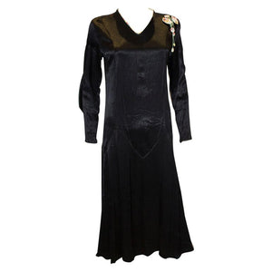 A Vintage Black Satin 1920s dress with floral trim