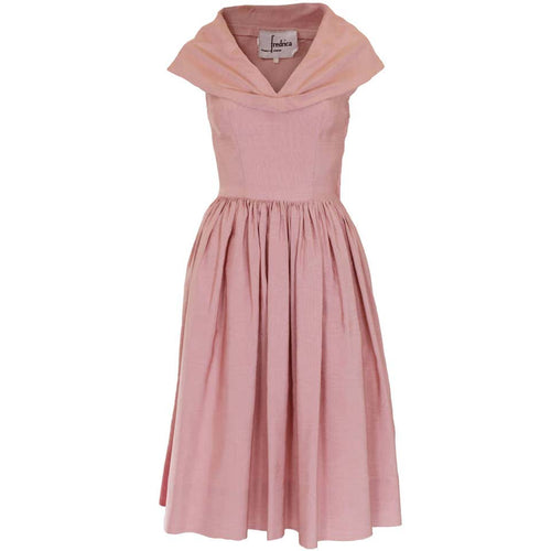 A vintage 1950s Dusty Pink Prom Style Vintage Dress