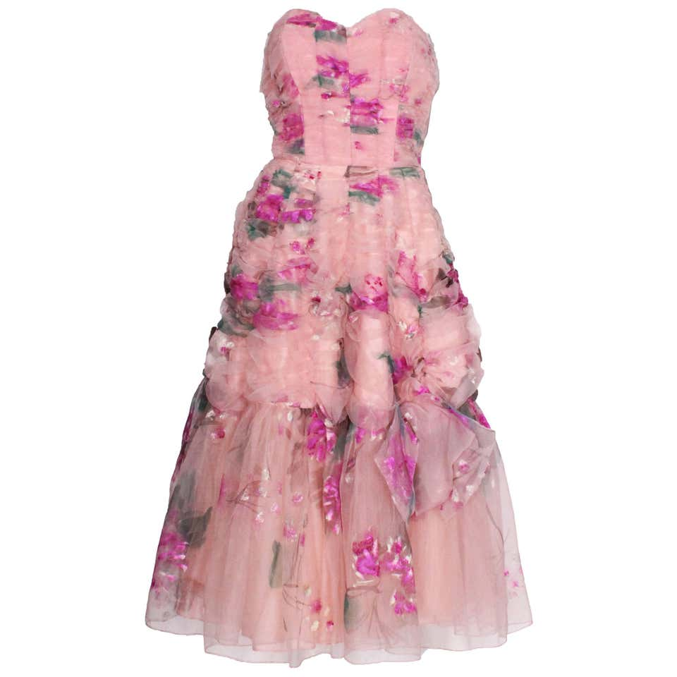 A vintage 1950s Handpainted Floral Pink Party Dress
