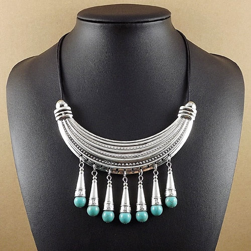Moon with Turquoise Beads and Tassel