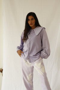 The fabric of this garment was found in Harajuku, Tokyo. The design was inspired by the street style, art and architecture of Japan. Different shades of lilac on the shirt to give it a fun subtle twist. INGREDIENTS 100% cotton Snap buttons Logwood IMPORTANT Natural dyes don't contain harmful chemicals, they are biodegradable, nontoxic and nonallergic. The color can slightly vary with each batch. Ethically made in Ecuador.