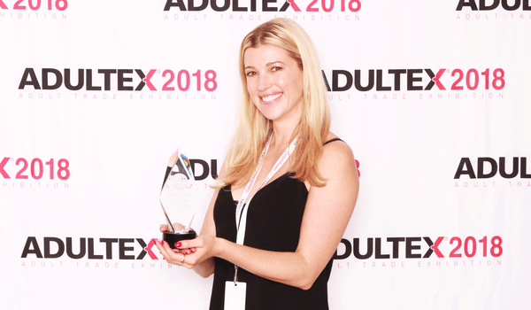 Alicia Sinclair accepts the Best New Product award for The Cowgirl Premium Sex Machine at Adultex