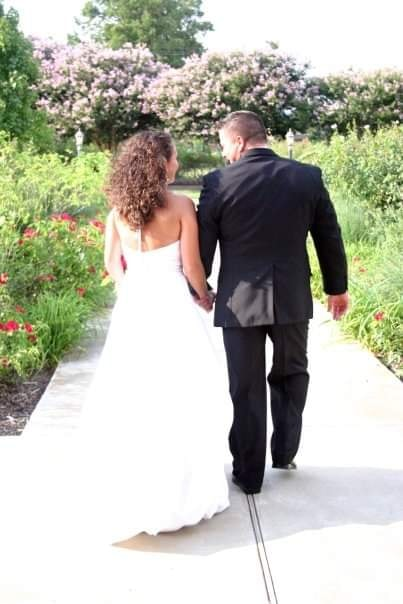 couple on their wedding day walking away from the camera together holding hands