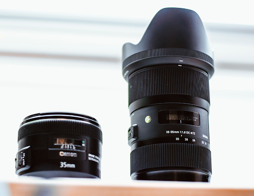 camera lenses displayed on a tabletop for home maintenance