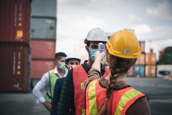 Does sweating mean fever is breaking: A foreman takes dock workers' temperature