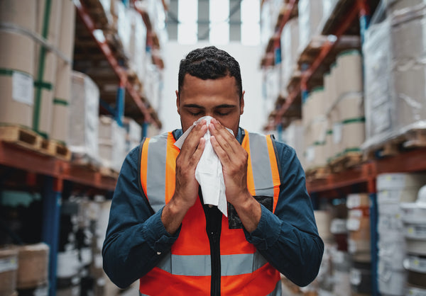 Does sweating mean fever is breaking: A warehouse employee blows his nose