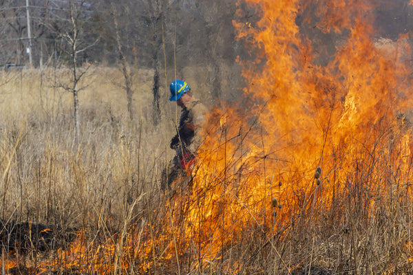 How long does heat exhaustion last: A fire fighter walks through a brush fire