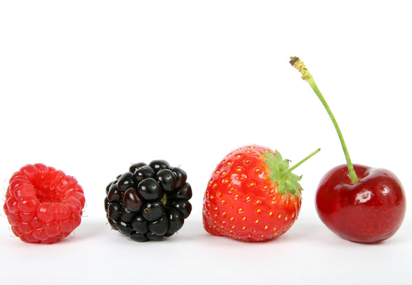 A raspberry, blackberry, strawberry, and cherry represent some of the flavors of DripDrop ORS