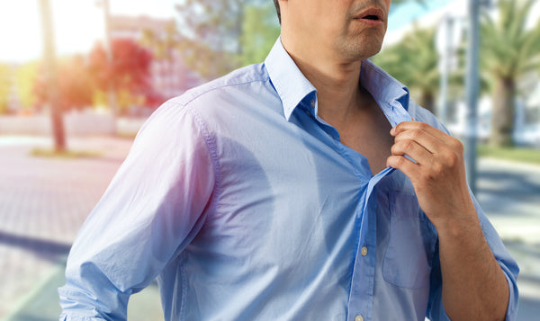 Why do I sweat so much: A man sweats through his shirt