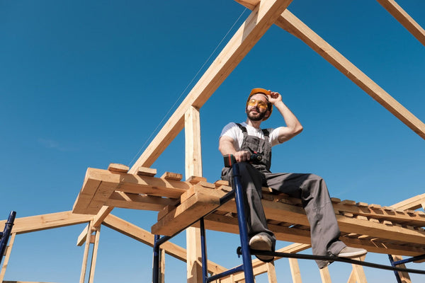 how to stop feeling tired: a man sitting on wood on a construction site