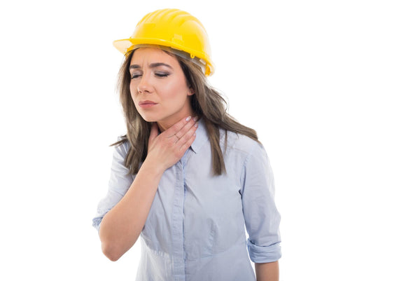 woman with her hand on her throat