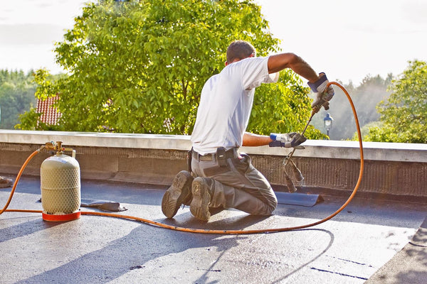 man working on the rooftop