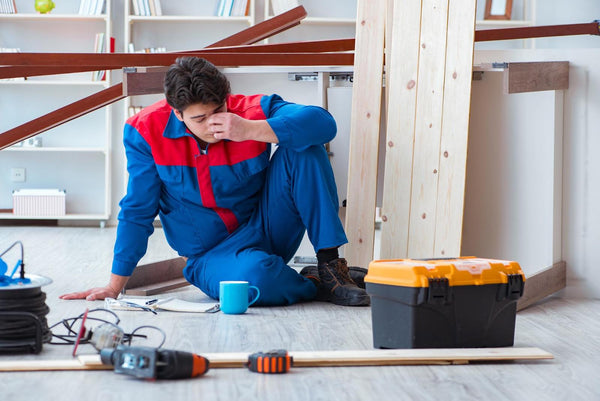 What happens if you don't drink enough water: Tired carpenter sitting on the ground
