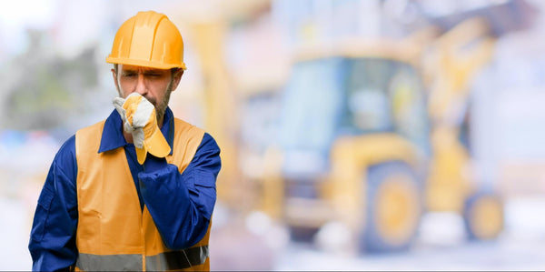 image of a construction worker with hands on his mouth