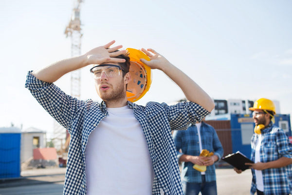 how to hydrate: a man sweating while on construction site