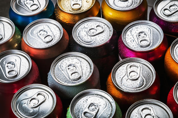 does soda dehydrate you: top view of different soda cans
