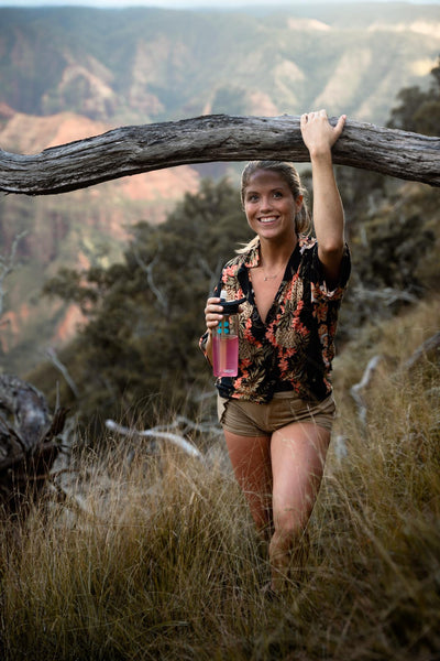 environmental allergies: woman with a tumbler full of DripDrop ORS outdoors