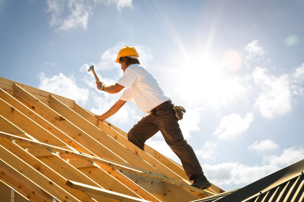 what to do for dehydration: carpenter working on a roof