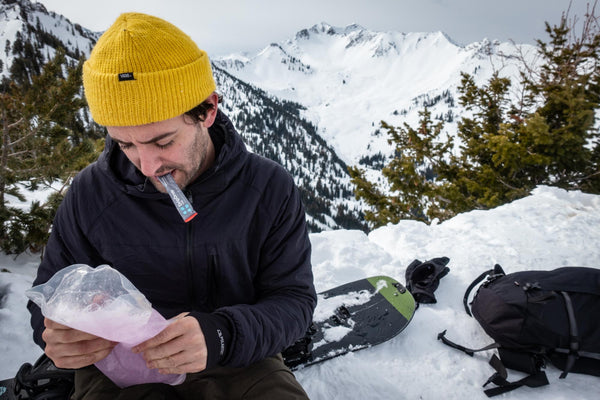 hydration powder: Man preparing DripDrop ORS while outdoors