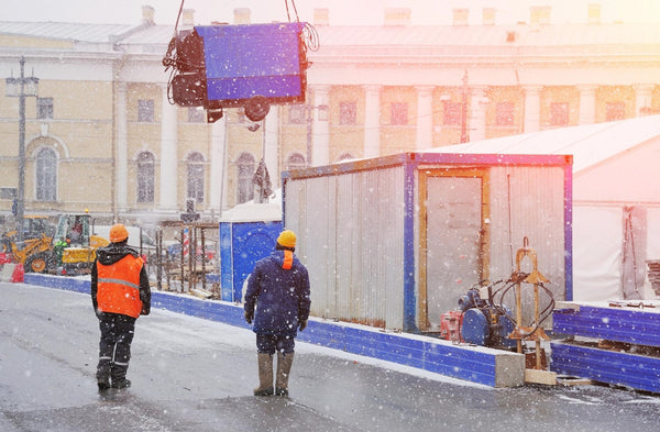 winter dehydration: Construction workers working amid snowfall