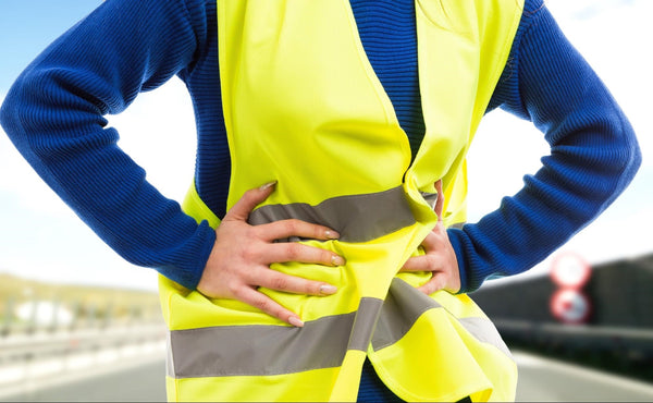 can dehydration cause UTI: Female worker clutching her lower abdomen