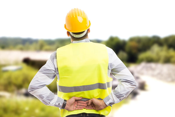 can dehydration cause back pain: hard hat worker stretching