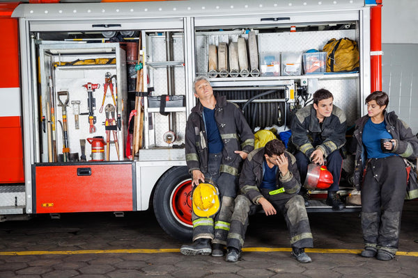 excessive daytime sleepiness: team of tired firefighthers at station