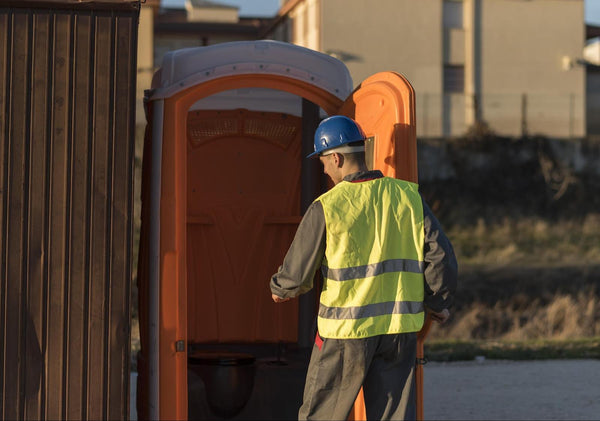 what is a diuretic: construction worker going inside the portable toilet