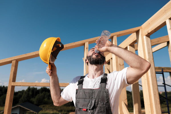 What happens if you don't drink enough water: Builder drinking his water